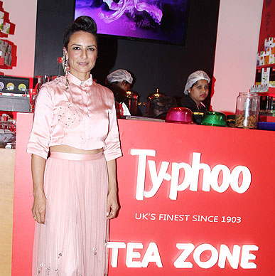 Creative minds deserve a much needed boost and that is why hairstylist Adhuna Akhtar could not miss having a sip of Typhoo to pep up her busy schedule Lakme Fashion Week